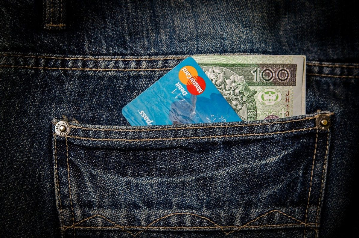 Money and credit card in a pocket